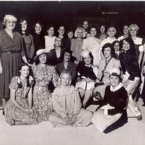 The cast of The Women, 1975. Jennifer Blocksidge is left front row, second from the end with broad-brimmed hat.
